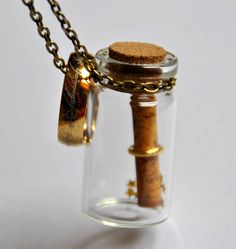 "Collana Mappa Il Signore degli Anelli Lo Hobbit. Map Necklace ""The Lord of the Rings"" The Hobbit, Middle Earth, in glass bottle, bronze color, vintage style, gold stars"