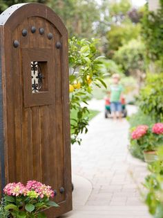 Make a bold garden entrance with a decorative wooden door. See the rest of this backyard makeover: http://www.bhg.com/home-improvement/porch/outdoor-rooms/family-backyard/?socsrc=bhgpin090412woodendoorgardenentrance