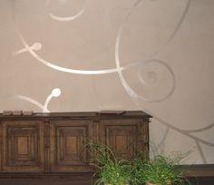 Wandgestaltung in Putz und Schablone