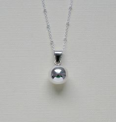 Harmony ball necklace - sterling silver round musical chime bola pendant charm - satellite - pregnancy baby - simple jewelry - Delilah  I have always wanted to get this!