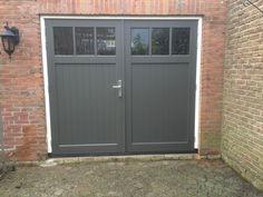 Hardhouten openslaande garagedeuren - Different Doors Garagedeuren