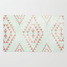 Buy Area & Throw Rugs with design featuring mint & coral tribal pattern by dani and adorn your home with both style and comfort. Available in three sizes (2' x 3', 3' x 5', 4' x 6').