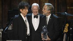 """Bob Dylan, former president Jimmy Carter, Neil Portnow -- Former President Jimmy Carter presented the award to Dylan, saying: """"His words on peace and human rights are much more insightful and much more permanent than those of any President of the United States."""""""