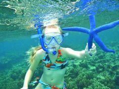 Snorkeling in Guam. Beautiful blue Starfish
