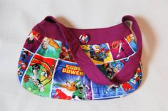 Impress your super friends with a Super Friends bag!  This pleated purse is made with a colourful retro Justice Leage print cotton and