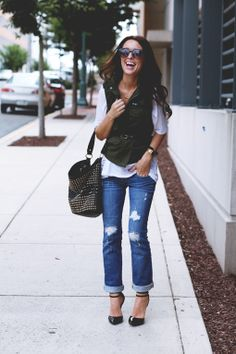 how does she make a boring military vest look so stylish? love.