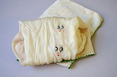1920s Stockings Ivory Silk Painted Art Deco Faces. $69.00, via Etsy.