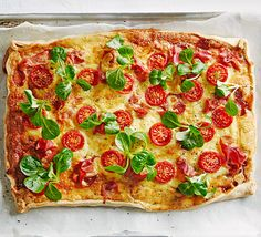 Layer up prosciutto, cheddar and cherry tomatoes on shortcrust pastry for a lovely light meal that's delicious hot, warm or cold