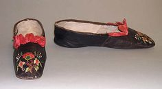 Embroidered leather slippers with ruched silk trim, American, early 1840s.