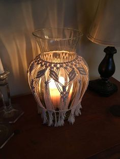 Beautiful Macrame Vase or Lantern. I made this during our evacuation for Hurricane Irma. When the power went out I had just completed the work on this. The candle glow from this lantern because of the macrame and the wave in the glass was even more beautiful than I anticipated. This