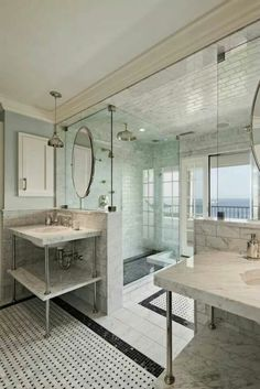 A spacious and serene bathroom with an ocean view.