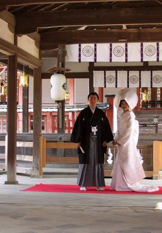 In a Traditional Japanese wedding the bride and groom will sit on a stage while the families give speeches