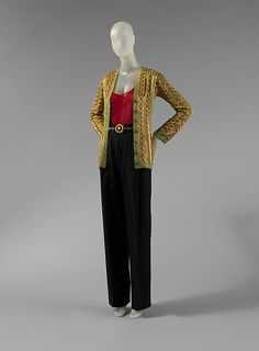 Yves Saint Laurent, Paris | Evening ensemble | French | The Met.  Fall/Winter Evening Ensemble by YSL. The ensemble is made of a silk/wool mixture. The blouse however would not have wool in it, the pant and jacket would have wool in it to keep the jewels stable. YSL used a variety of beading on this ensemble such as; plastic, metal, rhinestones and faux pearls.