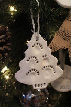 DIY white clay thumbprint ornament of grandchildren's thumbprints.