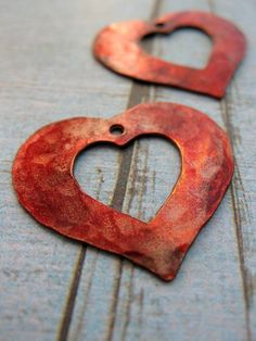 Would love to have a few of these strung on something and hand on my wall in our bedroom.....patina hearts