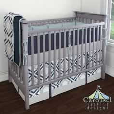 Crib bedding in Solid Navy Minky, Navy and Gray Geometric, Solid Robin's Egg Blue, Solid Navy, Solid Silver Gray. Created using the Nursery Designer® by Carousel Designs where you mix and match from hundreds of fabrics to create your own unique baby bedding. #carouseldesigns