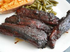 These are absolutely the BEST ribs ever! And relatively easy to make. Beth's Melt in Your Mouth Barbecue Ribs (Oven). Photo by NoraMarie Rib Recipes, Oven Recipes, Slow Cooker Recipes, Cooking Recipes, Cooking Ribs, Dinner Recipes, Cooking Salmon, Cooking Games, Barbecue Ribs