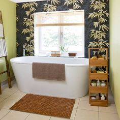 Oriental-style bathroom - A feature wall of dark, bamboo-patterned wallpaper, teamed with soft-green painted walls and bamboo storage units, creates a modern bathroom with a clean oriental feel.