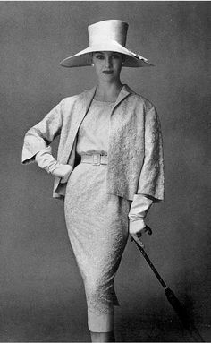 1957  Barbara Cailleux in slim embroidered linen dress belted in same fabric belt, worn with short buttonless jacket, by Pierre Balmain, photo by Georges Saad
