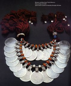 Woman's necklace from Taznit, Morocco (Berber) | Silver, Amber and shell | From the Colette and Jean-Pierre Ghysels Collection, and this photo is included in the publication 'The Splendour of Ethnic Jewelry'