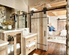 Barn roon separating bedroom and bathroom