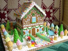 16 Insane Gingerbread Houses We Wish We Could Live In | LAWN ORNAMENTS | This elaborate creation not only includes an incredibly detailed gingerbread house, but a whimsical lawn studded with ice cream cones and Christmas trees as well.
