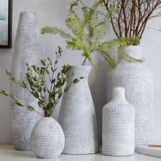 Made from earthenware stamped with small-scale patterns, our Textured Pure Ceramic Vases come in a range of shapes and sizes. Group a few together for a sculptural arrangement. 5 shapes —each under $50!