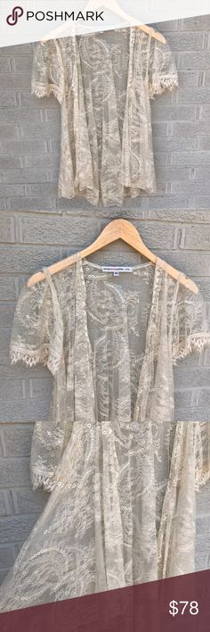 """Corey Lynn Calter Lace Drapey Open Front Cardigan Corey Lynn Calter Lace like Drapey Open Front off white Cardigan! This is absolutely beautiful! Perfect over a dress or top! The details of this Cardigan are stunning! Size XS. Nylon. 27"""" long. Previously loved. LT688071517 Corey Lynn Calter...clc... Tops"""