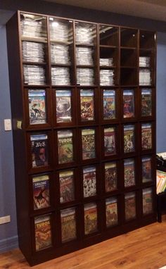 This is a full view of my custom CGC comic storage/ display cabinet.  Can hold about a thousand slabs in total.  Marine plywood frame, mahogany U-frame, tempered glass.  Each drawer can hold 25-30 slabbed comics, can also hold bagged/boarded books, paperbacks/hardcovers, etc.