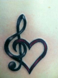 Treble clef and heart tattoo