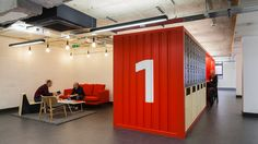 London office foregoes giant slides and game rooms for a new working philosophy that involves flexible co-working spaces and intimate meeting nodes.