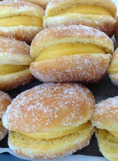 Bolas de Berlim - Sweet fried dough pieces filled with an egg custard filling.