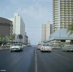 The Radio Centro Cinerama (left) on Calle L in Havana, Cuba, with the Habana Libre hotel (later the Hotel Tryp Habana Libre) on the right, 1964.
