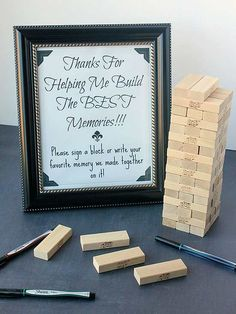 """Guest books are a great way to capture well wishes for the graduate, but all too often end up forgotten and collecting dust on a bookshelf. Sarah from Must Have Mom has created a guest """"book"""" that's anything but boring -- have guests leave their favorite memory on a Jenga block! Your grad will have a blast playing while reliving those special moments./"""