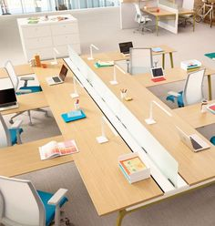 Who said workstations are old and boring? Haworth, Inc. got it right with their Intuity Benching