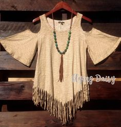 Western boho cowgirl style cold shoulder top with fringe. Flattering asymmetrical cut, made of cotton blend thick fabric with a unique washed look. Please see measurements below to get the right fit.