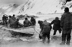 Members of Sir Ernest Shackleton's expedition struggle to move north in life boats after their ship is trapped in ice.