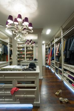 glazed cabinetry is the centerpiece of this extra large walk-in closet