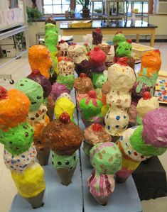 paper mache ice cream cones Love this for a June activity. Used a paper cup for cone and balls of newspaper for each scoop. They used masking tape to hold together until strips put on.