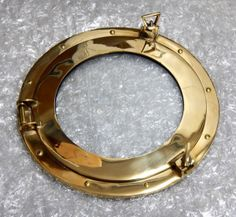 "15"" Brass Ships Working Porthole Clear. Folks use these in many creative ways; one favorite being a nautical beach theme picture frame. Overall solid brass housing measures 15 inches across in diameter. Depth is about 1/2"" except where porthole clamps are at 3"" tall. Weight 7 lbs. Glass portion is 9-1/4"" across in diameter. When fully functional porthole is opened, there is a circular space of 11-7/8"" across in diameter. Glass is easily removeable (see photo of …"