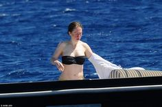 Chelsea took some time to bathe in the sun as she took off her long-sleeved shirt and sported a black bandeau bikini top