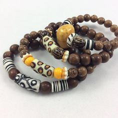 Wood and African Beads Stretch Bracelets – Loulia Pearl Jewelry Diy African Jewelry, African Beaded Bracelets, Beaded Jewelry, Pearl Jewelry, Jewlery, Leather Jewelry, Handmade Bracelets, Bracelets For Men, Earrings Handmade