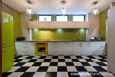 With pops of bright colour and retro influences, this trendy kitchen by Mint Kitchen Group
