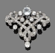 An aquamarine & diamond Belle Epoque brooch/pendant, ca The scrolling cartouche set with old brilliant-cut diamonds & a circular-cut aquamarine, diamonds approx total, later rhodium plated, length Diamond Brooch, Art Deco Diamond, Diamond Jewelry, Edwardian Jewelry, Antique Jewelry, Vintage Jewelry, Art Nouveau, Antique Brooches, Crystal Rhinestone