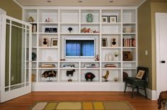 @Courtney Sobert I like a lot of the stuff on this page (the open pantries!) but if y'all chose to flip the den a tv in the shelving would be awesome!