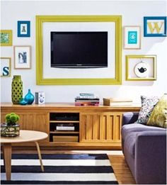 "3.  Frame It.  This is a very creative solution because it's your television saying ""Yes, I'm here, and I'm fancy!""  Go rustic chic like Cassity with her DIY version or bold with color!  Either way, you've announced your television is a focal point, but given it some pizazz in the process."