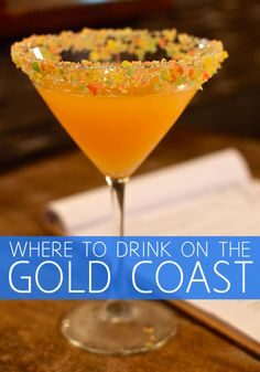 Poprocktini, a sweet passionfruit, peach and apple vodka based drink in a martini glass rimmed with crushed Poprocks from Elston Bar, Surfers Paradise. Click through to find out the best places to drink on the Gold Coast, Australia!