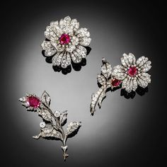 Victorian Burmese ruby and diamond brooches, mounted en tremblant. #burma #burmese #ruby #victorian #burmaruby #tremblant #antiquejewels #antique #brooch #auction #woolleyandwallis