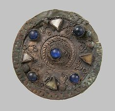 Date:     ca. 600–650 Culture:     Frankish or Northern French Medium:     Silver, wire, glass paste, copper alloy core, cabochons Dimensions:     Overall: 1 7/16 x 9/16 in. (3.7 x 1.5 cm)