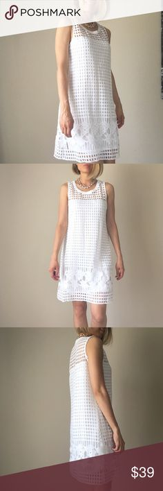 White dress Best white modern summer dress. Tasteful and fun . Patchwork crochet cutout outer shell with inner lining. 100% poly . Hand wash old no dry clean more so on next listing Dresses Midi